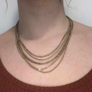 Two layered gold coloured necklaces